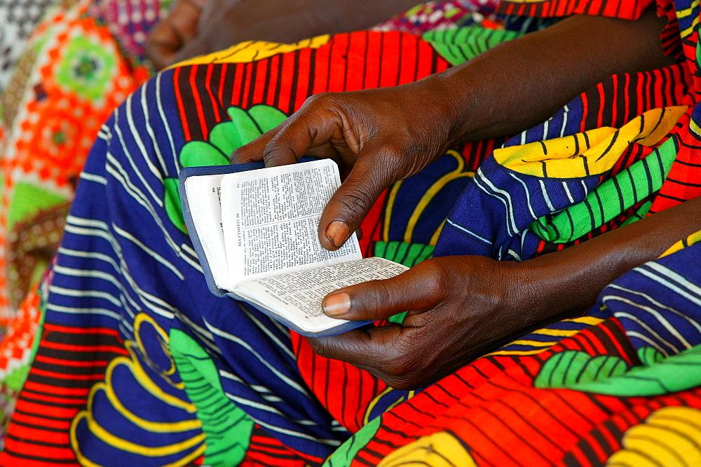 Hands holding a hymn book at a church service, Garoua, Cameroon, Africa - 832-306657