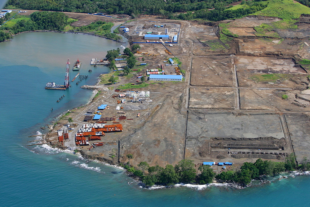 Refinery and harbour premises being built, at a nickle mine, chinese mining association, Basamuk, Papua New Guinea, Melanesia,