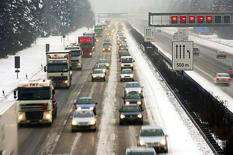 Highway at wintry road conditions, traffic jam on the higway