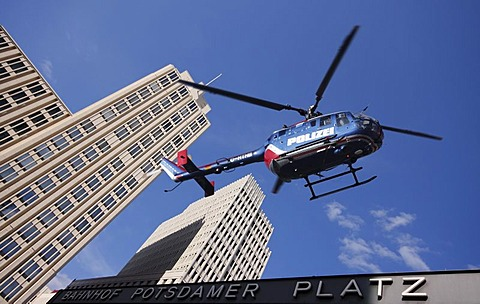 Police helicopter above Potsdamer Platz Square with the Beisheim Center, Berlin, Germany, Europe