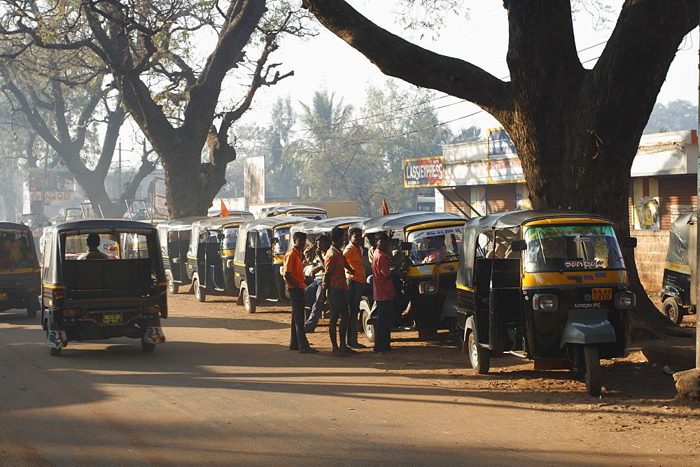 Tuk-tuks in line, waiting for passengers, Badami, Karnataka, India