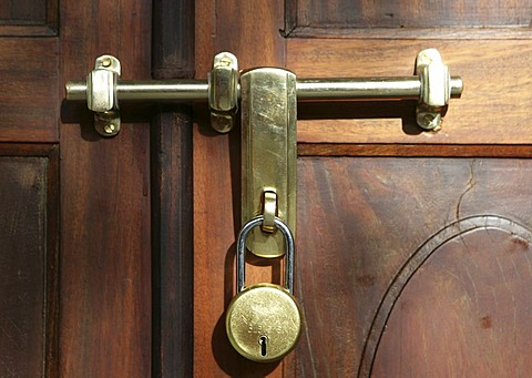 Latch with padlock on a wooden door