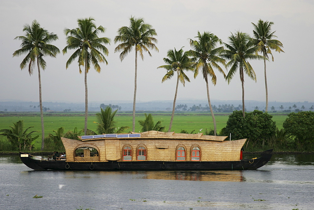 Typical rice boats on the Backwaters, a canal system along the coastline, boat is also accommodation for tourists, Kerala, India