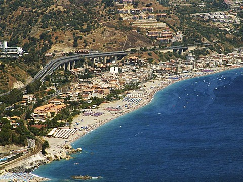 ITA, Italy, Sicily : The town of Taormina, in the northeast of the island. Motorway at the coast near Mazzeo. |