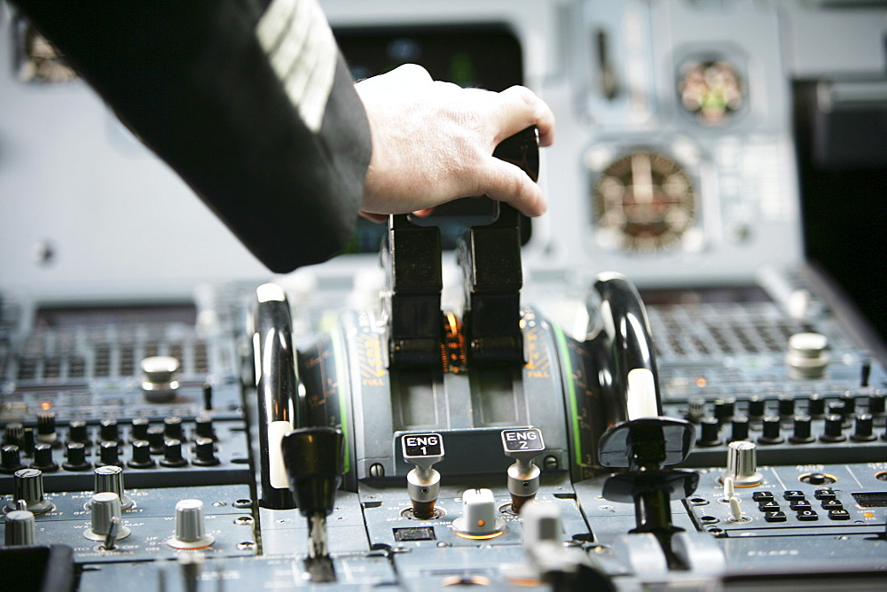 Pilot in cockpit of an Airbus A319, take off, engine power