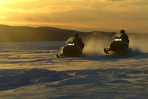 CAN Canada Quebec : Snowmobile driving during winter region Saguenay - Lac Saint Jean Monts Valin.