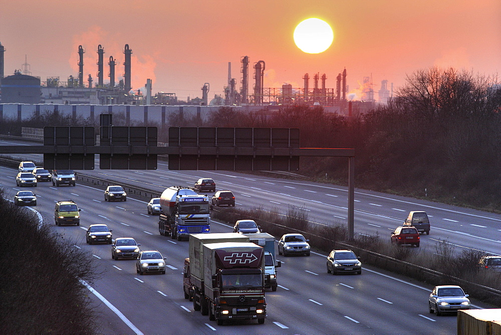 A3 Autobahn (motorway) near Oberhausen-Holten at sunset, OXEA Ruhrchemie chemical plant in background, Oberhausen, North Rhine-Westphalia, Germany, Europe