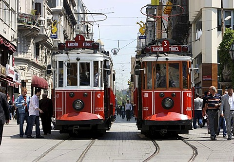 Trams passing through the main pedestrian zone, Istiklal Caddesi in the Boyoglu district, Sultanahmet, Istanbul, Turkey - 832-316148