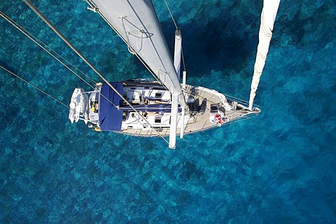 Sailing yacht in turquoise blue ocean