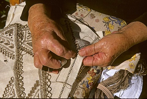 Old female hands embroidering, Cyprus