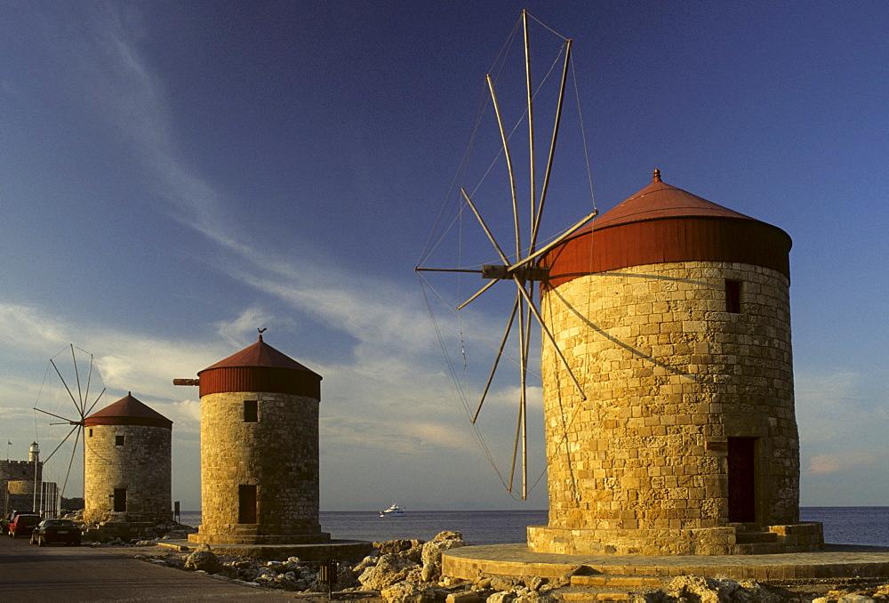 Three windmills on the pier in Mandraki Harbour, Rhodos Island, Dodecanese Islands, Greece