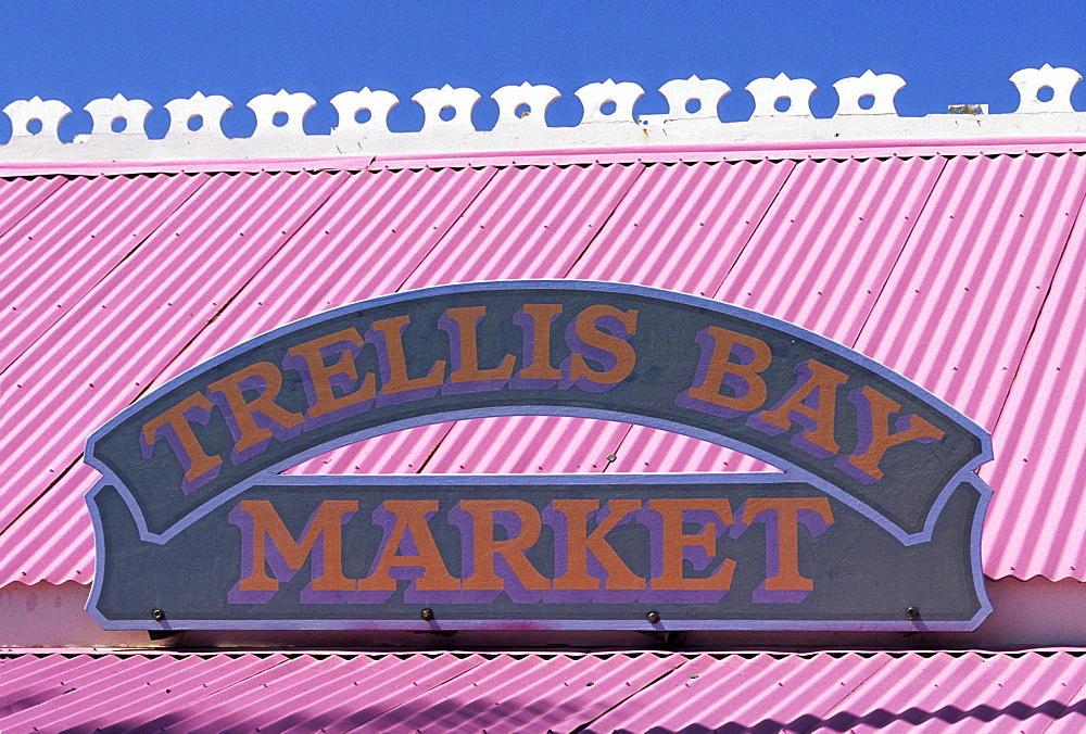 Sign on a pink tin roof at a small supermarket on Beef Island, British Virgin Islands, Lesser Antilles, Caribbean