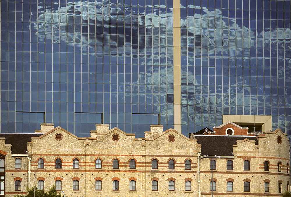 Old harbour building in front of modern glass office building, Darling Harbour, Sydney, New South Wales, Australia