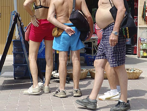 ESP, Spain, Balearic Islands, Mallorca : Half naked tourist, in bathing suits, on a market in Alcudia.