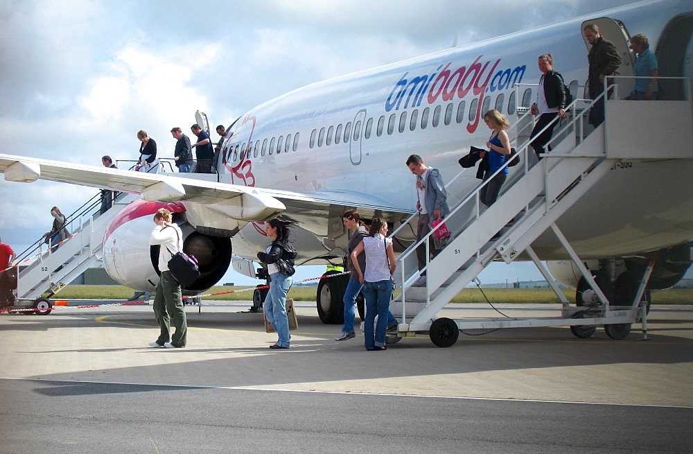 Passengers leaving a Boeing 737 of bmibaby at Newquay Airport, Cornwall, Great Britain