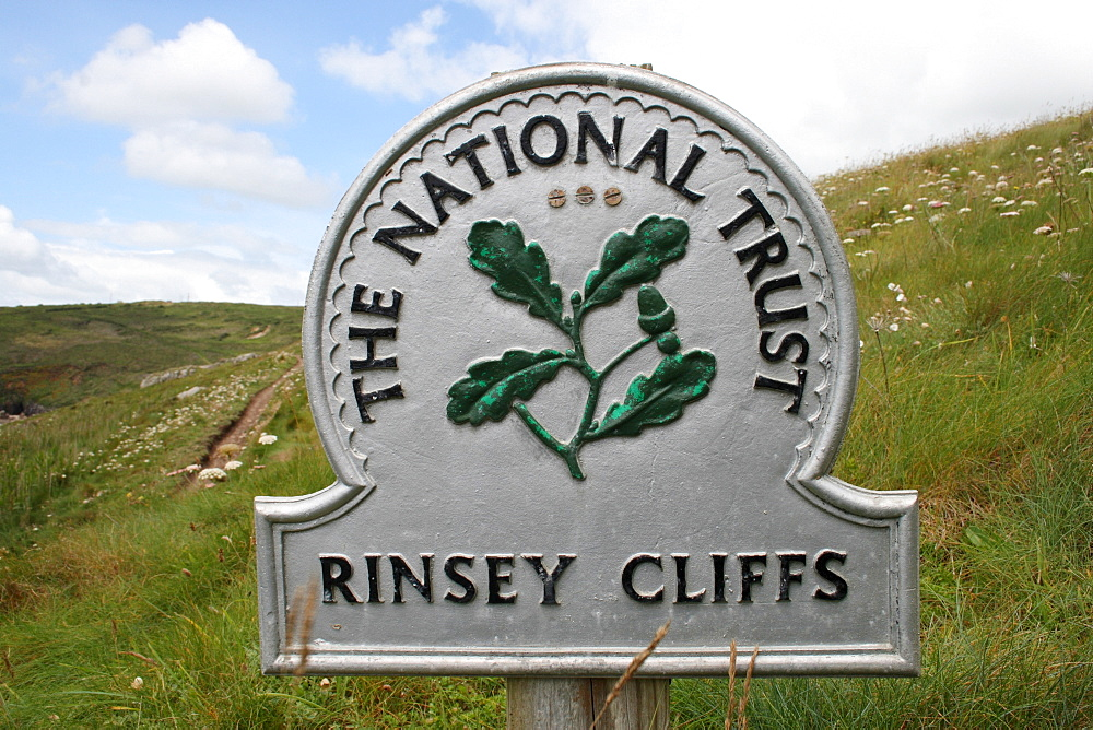 "Sign "" The National Trust"" at the Rinsey Cliff, Cornwall, UK"