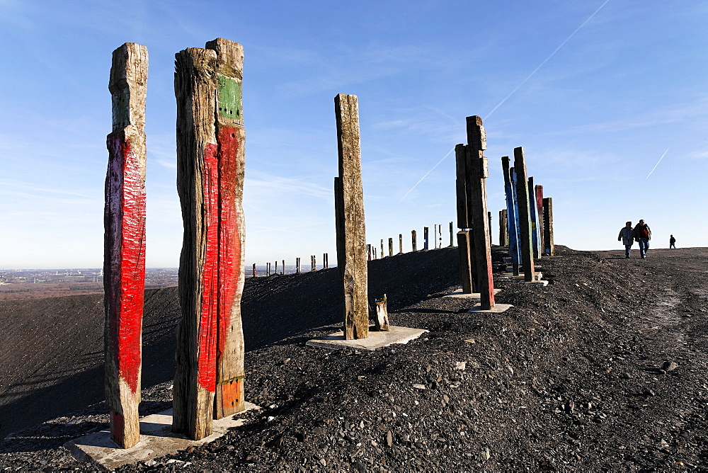 """Totems"" art installation by Basque artist Augustin Ibarrola, painted railway ties at the top of the Haniel spoil pile, Bottrop, North Rhine-Westphalia, Germany, Europe"