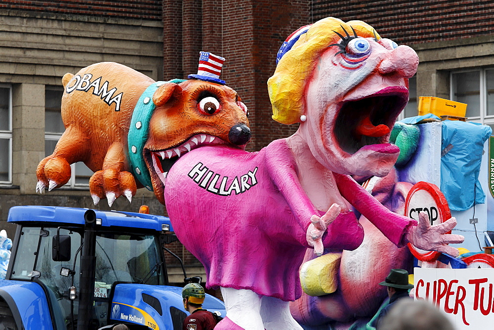 Political caricature, paper-mache Barack Obama biting Hillary Clinton in the ass, Carnival (Mardi Gras) parade in Duesseldorf, North Rhine-Westphalia, Germany, Europe