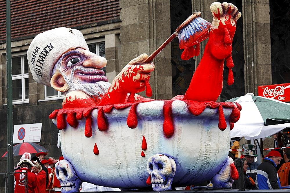 Political caricature, paper-mache Osama Bin Laden bathing in blood, Carnival (Mardi Gras) parade in Duesseldorf, North Rhine-Westphalia, Germany, Europe