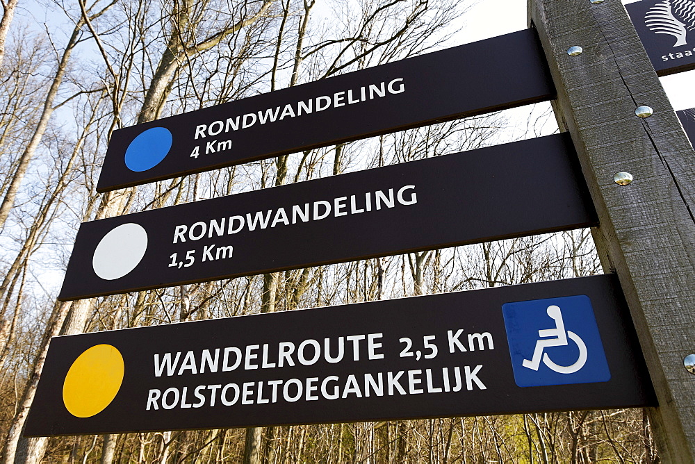 Walking routes signpost in Dutch, some suitable for wheelchairs, Westhove Palace near Domburg, Walcheren, Zeeland, Netherlands, Europe
