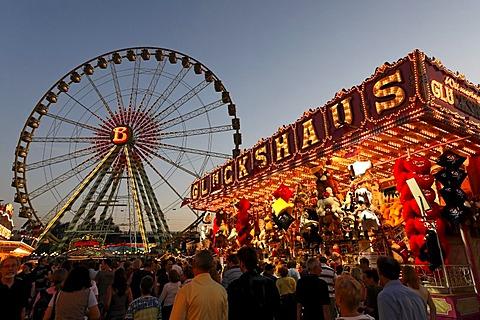 Ferris wheel and Good Luck House, Rhine fair, Duesseldorf, NRW, Germany