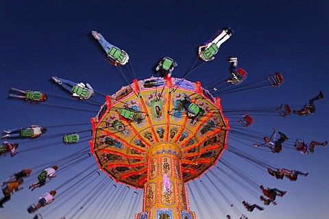 Chairoplane riding at nightfall, Rhine fair, Duesseldorf, NRW, Germany