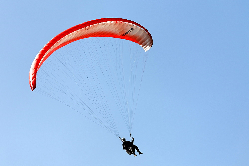 Paraglider banking in the air, Lower Rhine, NRW, Germany
