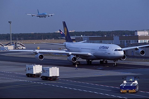 Airport , Lufthansa Airbus on the way to the start position, background Jumbo Jet in landing situation