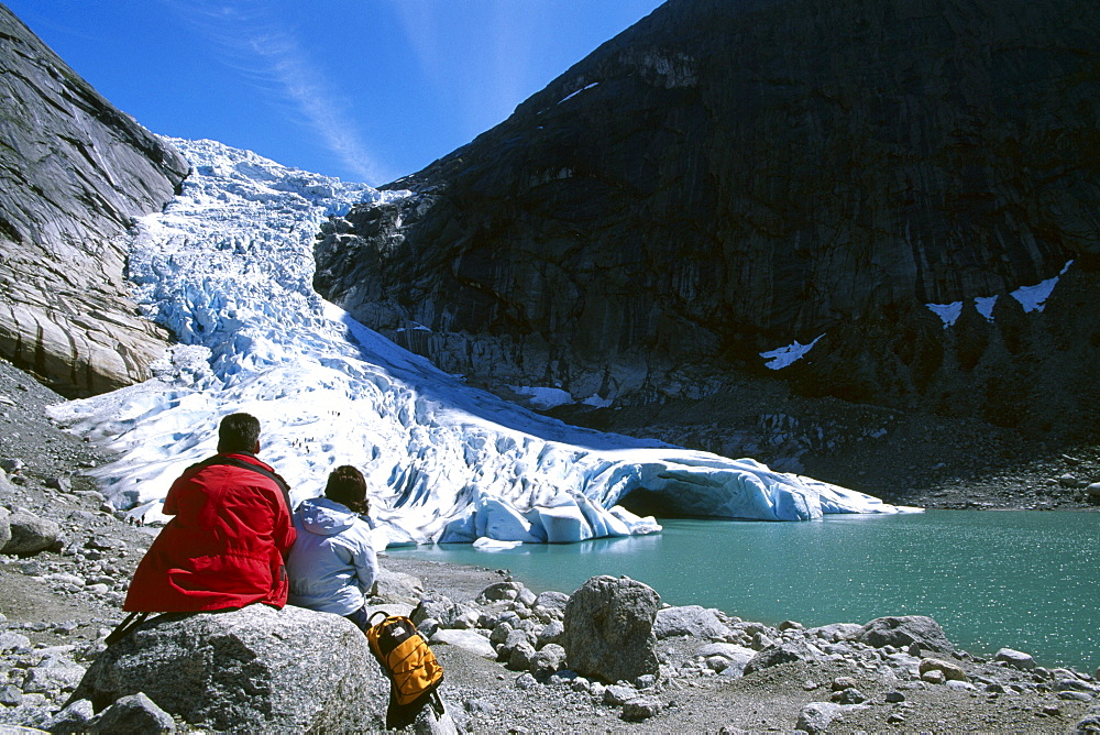 Tourists looking at the tongue of the Jostedalsbreen, Jostedal Glacier, Norway, Scandinavia, Europe