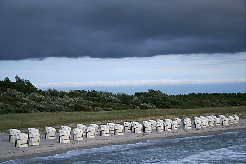 Rain clouds over beach chairs on a beach of the Baltic Sea in Fischland, Mecklenburg-Western Pomerania, Germany