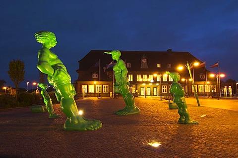 Slanted sculptures - Reisende Riesen im Wind - of artist Martin Wolke in front of Westerland railway station, Sylt, Schleswig Holstein, Germany