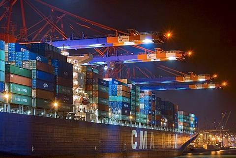 Large container ship lying at Hamburg Harbour at night, container terminal Eurokai, Hamburg, Germany
