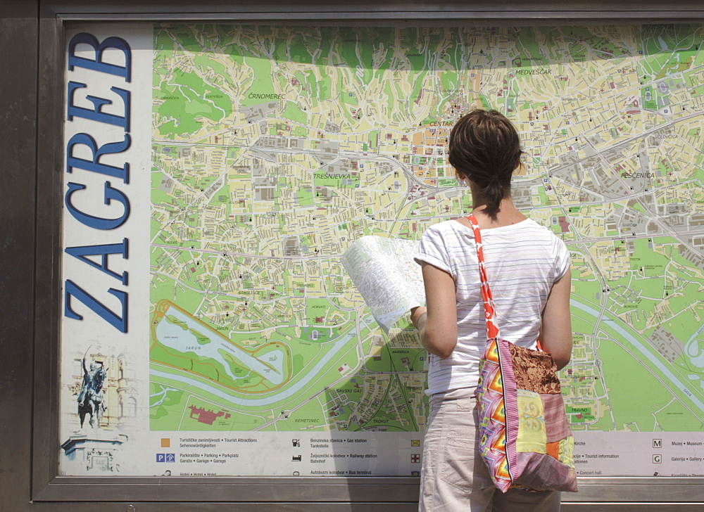 Female tourists looking at city map, Zagreb, Croatia