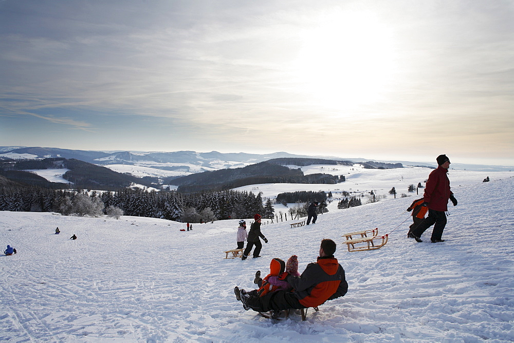 Sledders, Mt. Wasserkruppe, Rhoen Mountains, Hesse, Germany, Europe