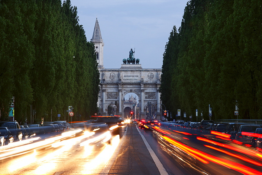 Siegestor, Victory Gate, with light trails from traffic in Leopoldstrasse Street, Munich, Upper Bavaria, Germany, Europe