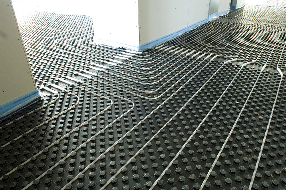 Construction of a hospital, laying an underfloor heating, Gelsenkirchen, North Rhine-Westphalia, Germany - 832-327697
