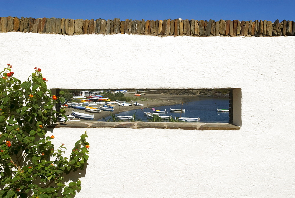 Bay viewed through a rectangular panorama window on the former house of surrealist painter Salvador Dali and his wife Gala in Port Lligat near Cadaques, Catalonia, Spain