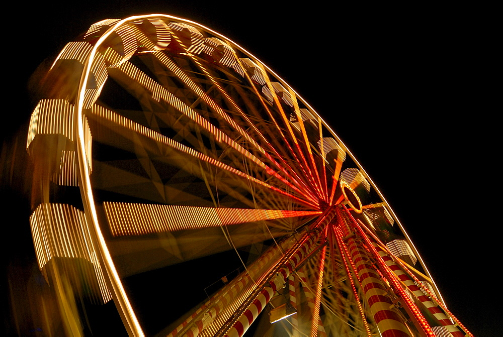 A big wheel on a annual fair - Baden Wuerttemberg Germany Europe.