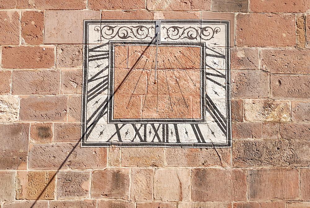 Sundial on the wall of Muenster Abbey, Villingen, Baden-Wuerttemberg, Germany, Europe