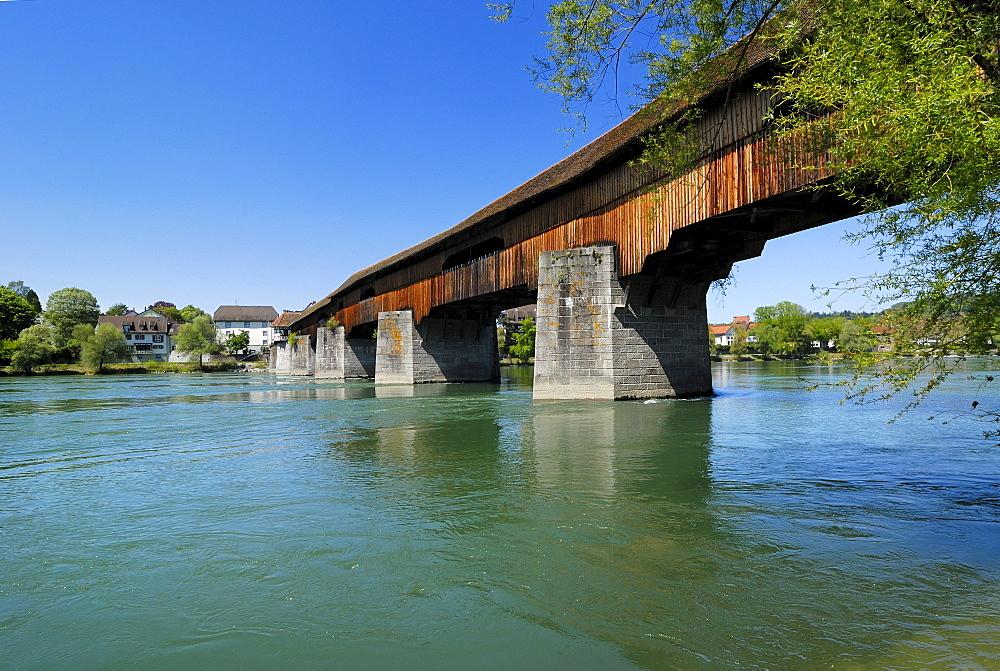 The historic covered wooden bridge over the Rhine River, Bad Saeckingen, District of Waldshut, Baden-Wuerttemberg, Germany, Europe