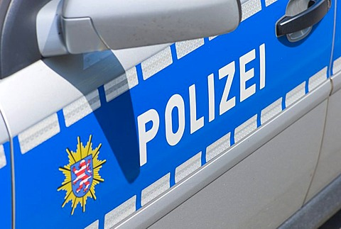 Police in lettering on a police car, Germany, Europe
