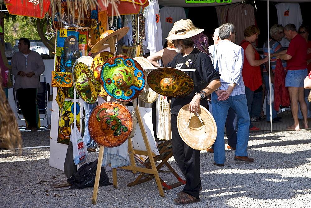 Famous hippie market near Sant Carles (Carlos), straw hats, Ibiza, Baleares, Spain