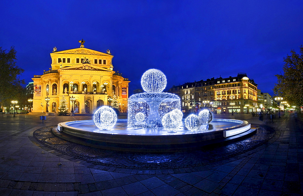 Alte Oper (Old Opera) with special christmas illumination of the fountain, Frankfurt, Hesse, Germany