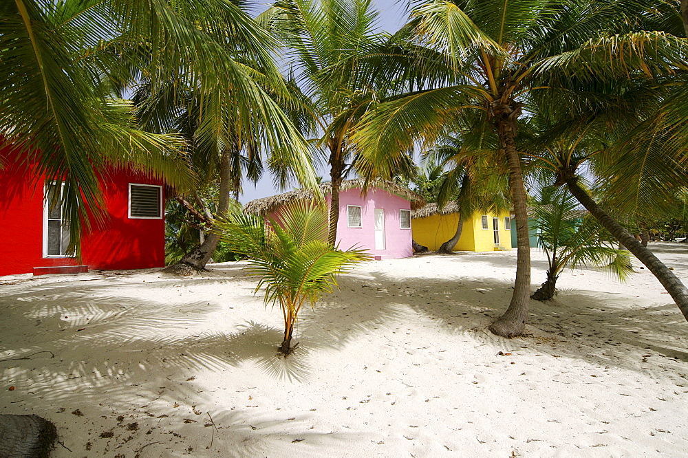 Colourful Caribbean guesthouses on the beach, Catalina Island, Dominican Republic, Caribbean, Americas
