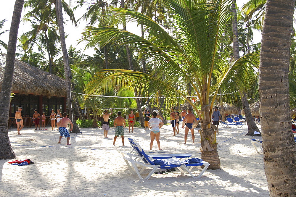Tourists playing beach volleyball at an all-inclusive resort as part of the its organized activities program in the Dominican Republic, Caribbean, Americas