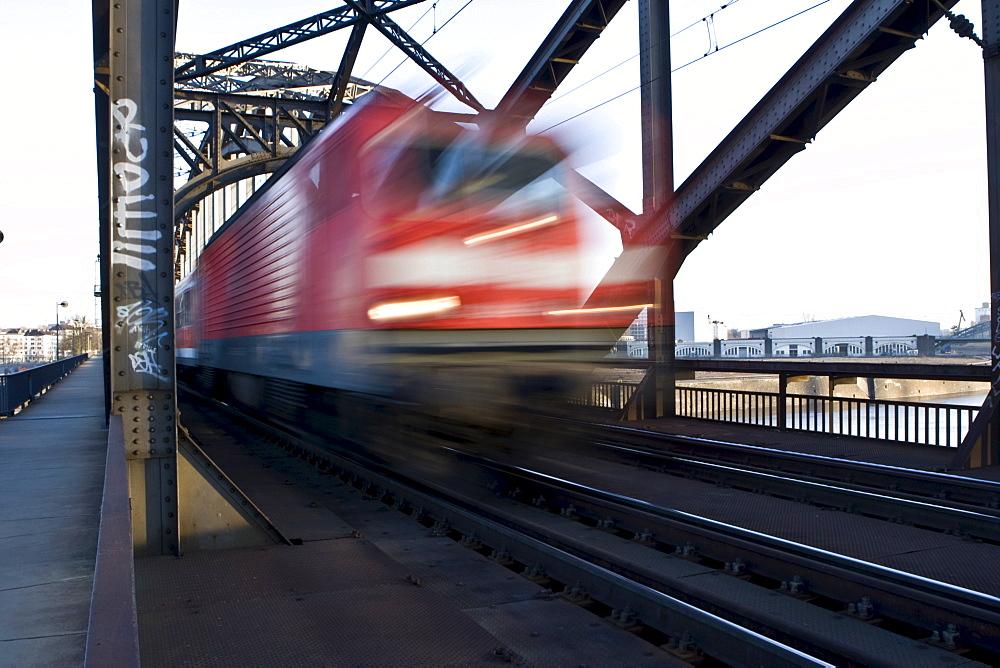 German Rail train driving over a bridge fast, Hesse, Germany, Europe