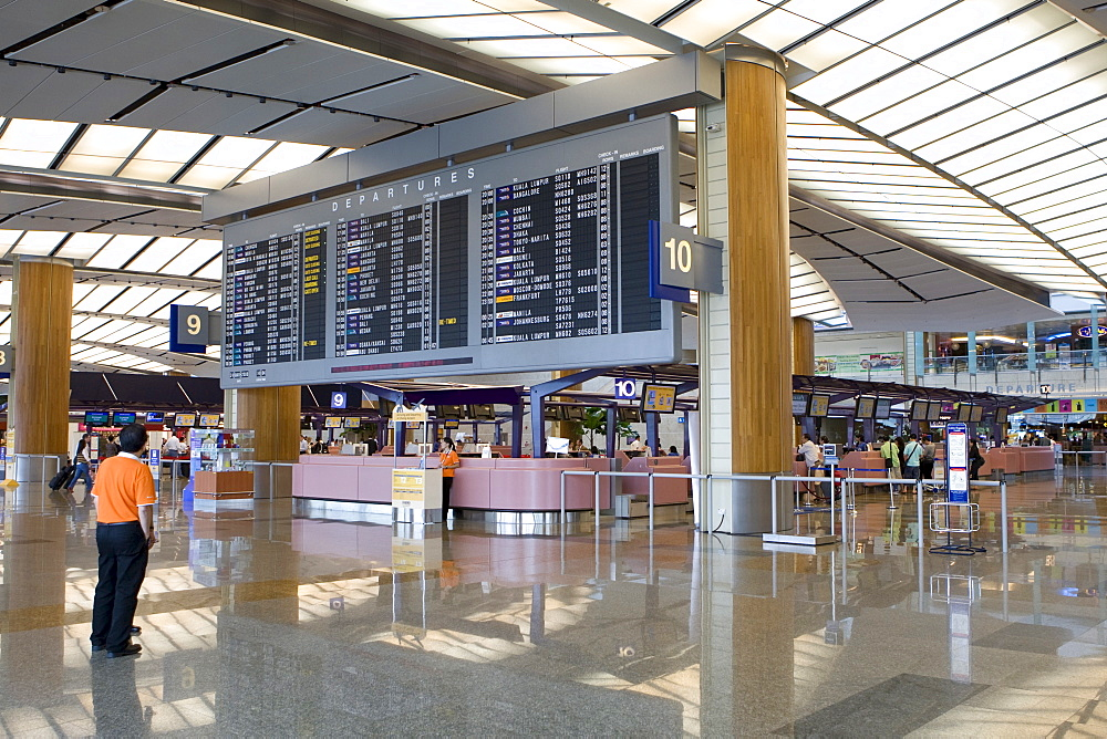 Departure hall, departure board and check-in counters at Changi Airport, Singapore, Southeast Asia