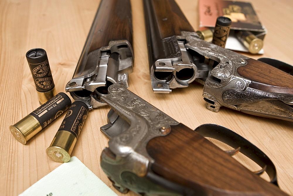 Two hunting weapons, shotguns, long guns with engraving, shooting license and gun ownership license