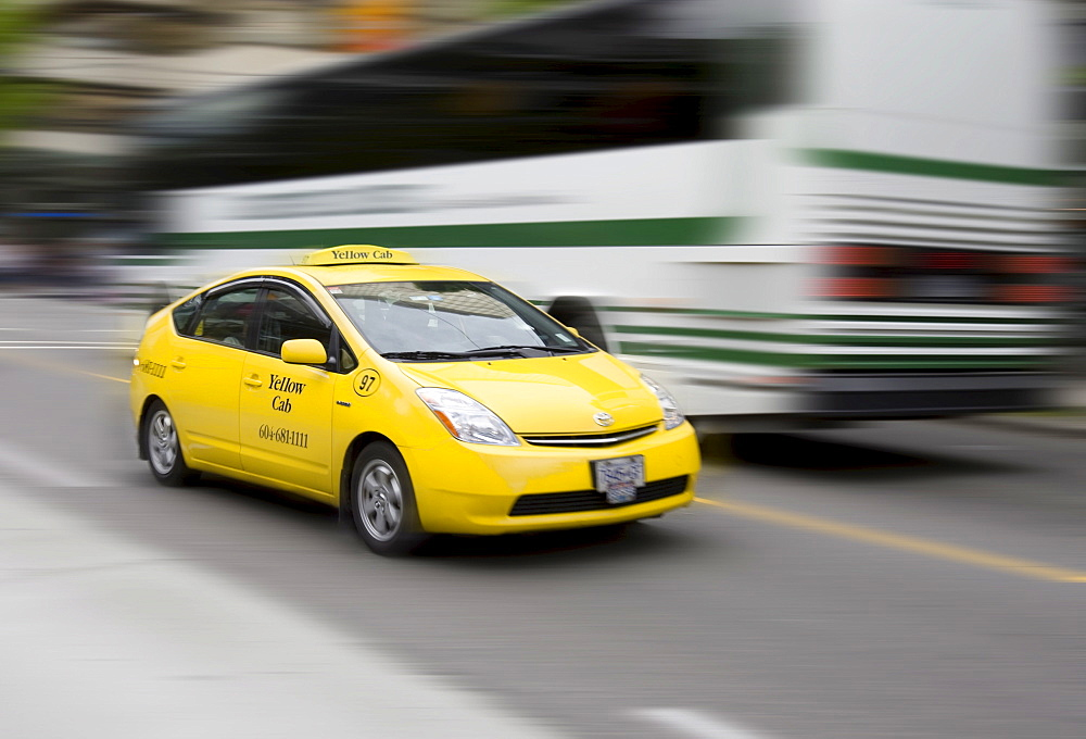 Taxi, Yellow Cab, in motion, Vancouver, British Columbia, Canada, North America