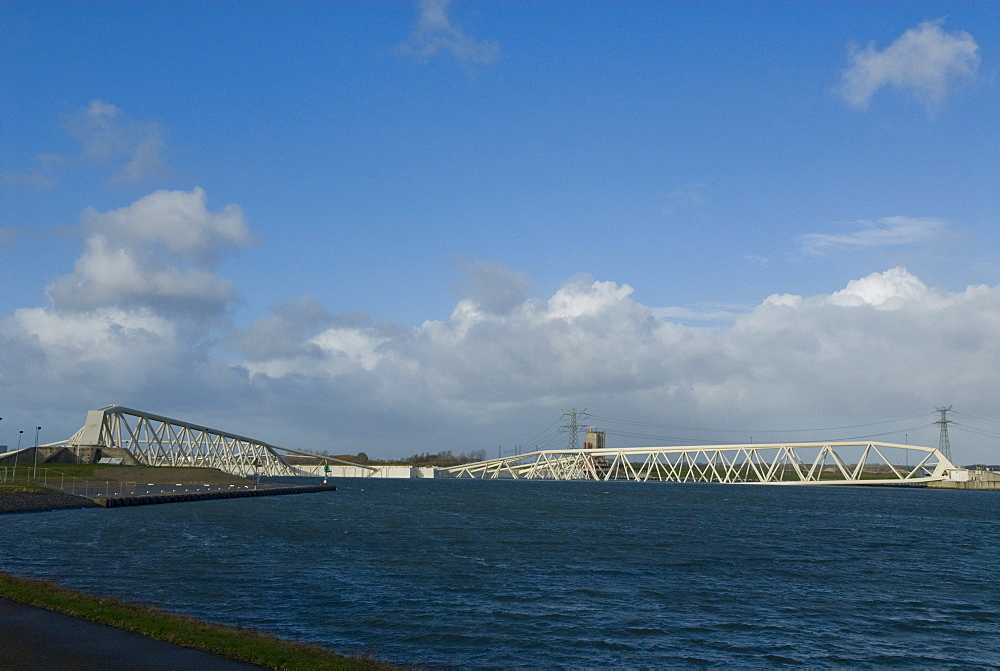 Closed storm surge barrier The Maeslantkering in the Nieuwe Waterweg waterway between Hoek van Holland and Maassluis, part of the Delta Works, Netherlands